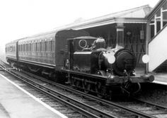 LBSCR 'Terrier' 0-6-0T No 55 Stepney passes Ardingly with two coaches LSWR No 320 and SR No 6575 en route to Sheffield Park for the commencement of Bluebell Railway passenger services in May 1960. BLUEBELL ARCHIVES