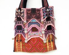 It's a beautiful handmade bag with Burma style. The main part are made from the Hmong hill-tribe embroidery which done with skillful needlework. embroidery which every part is different from the others. Besides, the coins and the small bells you see are Burma items and they super perfectly match when they all are together whice mean this bag is made from our heart then it's definitely rare item.  http://www.etsy.com/listing/96677684/hand-embroidered-ethnic-tote-tribal