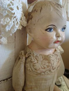 A beautiful old doll. I wonder what lives the little girls who owned her went on to have!