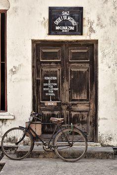 Stone Town, Zanzibar by neildakeyne, old door, rustic, details, architechture, signs, bicycle, bike, wheels, steps, photograph, photo