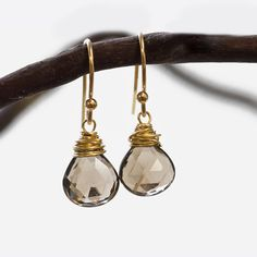 With energetic hand wire work, these gem earrings are simple yet stunning. Beautiful Smoky Quartz, no two pair are alike as they are hand cut gemstones and we also choose the very best stones we have.