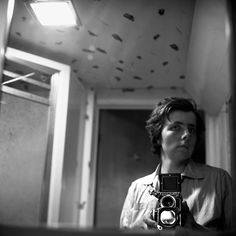 oh my.. Vivian Maier.. and her Rolleiflex... WOW.. look up into the lower twin lens..