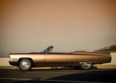 Sleek '67 Cadillac de Ville convertible.