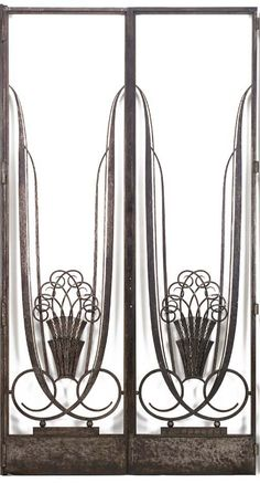 A pair of Patinated Wrought-Iron Doors (1920s) by French designer  decorator Raymond Subes (1893-1970). Backed with mirrored panels in wrought-iron frames; each panel 107.25 in high, 29.75 in wide. via Christie's