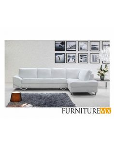 Contemporary sectional features a tufted white color with stainless steel accents. Perfect for most modern designed homes and lofts.