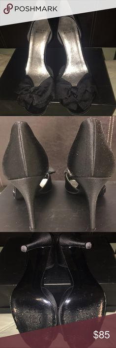 Stuart Weitzman Black Satin D'orsay Bow Heels Stuart Weitzman Black Satin Bow Dress Shoe in great condition. Beautiful for an evening gown or jeans and blazer!  D'orsay heel with peep toe. Very comfortable Stuart Weitzman Shoes Heels