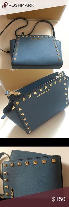 Michael Kors mini blue sema crossbody handbag Only used twice. Really like new condition Michael Kors Bags Crossbody Bags