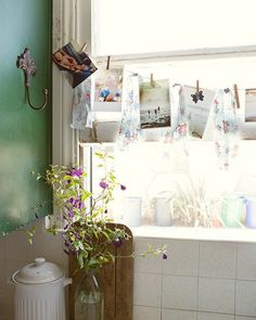 A kitchen window will do (or any window, for that matter.)  I think a simple string with clothes pins is such an appealing way to display those wonderful and beautiful art pieces your kids create.