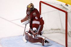 Arizona Coyotes' Mike Smith is unable to make a glove side on a shot by Buffalo Sabres' Andrej Meszaros, of the Czech Republic, for his second goal during the second period of an NHL hockey game Monday, March 30, 2015, in Glendale, Ariz. (AP Photo/Ross D. Franklin)