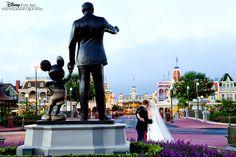 Sweet Disney couple in front of the Partner's statue at Magic Kingdom #Disney #wedding #MagicKingdom #bridalportrait