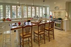 Love the long bench with the windows and no cupboards above  McEvoy Kitchen traditional kitchen
