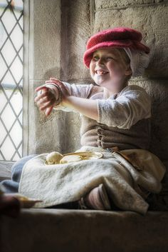 Young reenctor, The Tudor Group at Haddon Hall, Derbyshire.-Love her cap and coif.
