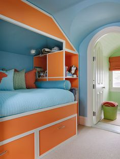 When opposite colours on the colour wheel, orange and blue do a perpetual 'dance', it is a cheerful sight to behold. Orange, Blue, Coral, Turquoise,  boys bedroom.