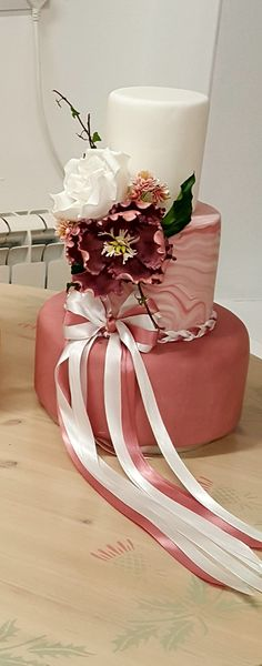 Simple wedding cake with pink marbled finish and correct sugar flowers