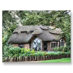Thatched roof cottage with large diamond bay window...