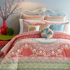 Transform your bedroom into an exotic garden with the lively Jessica Simpson Amrita Medallion Comforter Set. Adorned with over scaled floral medallions and luscious vines, the coral and blue bedding is a vibrant addition to any room's décor.
