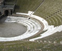 Theatre in Pompeii. Shallow marble steps at the front where the aristocracy would have sat on cushioned stools. The plebs sat on stone seats behind them, separated by a low wall. Feb 2015