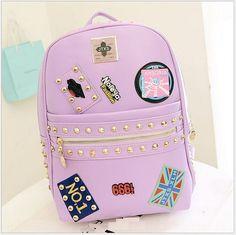 2015 único de moda del remache del estilo mujeres insignia de cuero mochila mochilas bolsas escuela para adolescentes Ladies viaje ocasional