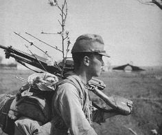 Japanese Army soldier carrying a Type 11 machine gun.