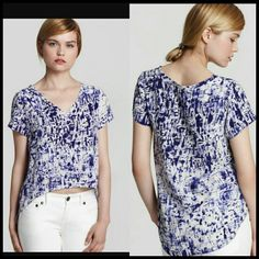 Gryphon Top White/purple printed v neck top w/ short sleeves & high low hem. True to size.  100% silk. Gryphon Tops