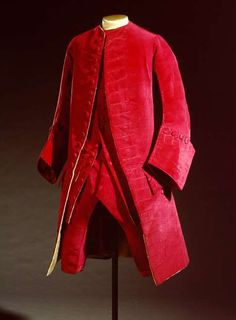 The justaucorps, a close-fitting knee-length coat which made the figure appear smooth and round, determined the stylish silhouette of gentlemen in the 18th century. The slightly rounded front hem shows parts of the vest and the breeches. The sword was worn under the flared skirts.