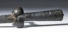 This is a distinctive dagger with a thin, sharp blade and strongly phallic shape, as sugge. Swords And Daggers, Knives And Swords, Medieval Weapons, Wooden Vase, Stone Sculpture, Grey Stone, Wooden Handles, Blacksmithing, Carving