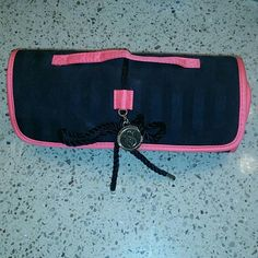 VS rollup makeup case Never been used makeup bag from Victoria's Secret! Awesome for storing brushes, eyeliner and other smaller beauty items for travel! The pouch in the center detaches & can be used alone. It also has leopard print detailing on the zipper. Victoria's Secret Bags Cosmetic Bags & Cases