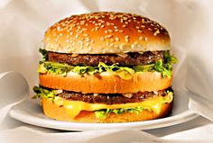 BIG MAC. Looks pretty tempting right? No one has ever got a big mac that actually looked like this. The meat is grey, the bread is squashed and the salad withered. Photoshop for food.