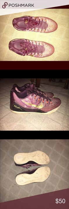 Nike basketball shoes A burgundy ish colored shoe with cool designs and a gold Nike swoosh Nike Shoes Athletic Shoes