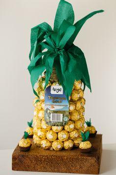 @kitchenoftreats - Moet bottle covered in Ferrero Rocher's.