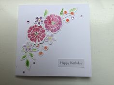 Stampin up Falling flowers stamp, white embossed then painted and die cut before assembling on the card