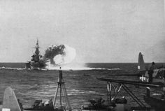 USS North Carolina bombarding Nauru, 8 Dec 1943; note OS2U Kingfisher aircraft in foreground. (US Navy photo)
