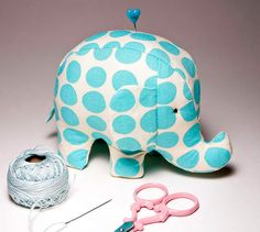 Turquoise Sunspots Elephant PIncushion by VeronicaMade, via Flickr- love this elephant pattern