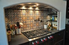 LOVE this Mediterranean-style mosaic for my (dream? future?) kitchen.