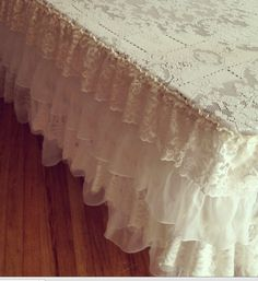 Ruffled lace tablecloth made from repurposed vintage linens. For rent at www.somethingvintagerentals.com