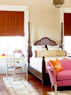 Playful colors work well with the beautiful bed and wood floors -