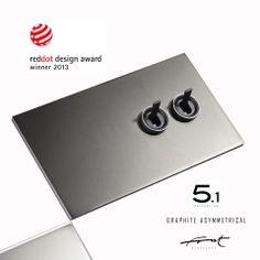 5.1 Asymmetrical Graphite Brass  RED DOT Design Award winner 2013  - Double two-way-switch, asymmetrical graphite brass, graphite toggles & rings,  - Doble conmutador, placa asimétrica de latón grafito, manecillas y arandelas grafito - Double va-et-vient, plaque asymétrique de laiton graphite avec leviers et anneaux graphites.