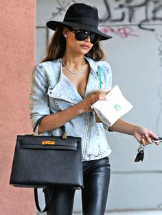 Naya Rivera stays under the radar in a black fedora and large sunnies while running errands.