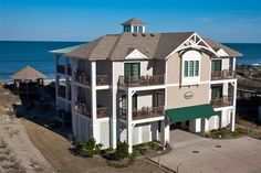 SOL MATE, #846 l Corolla, NC Vacation Rental Home l Oceanfront, 10 bedrooms (8 master suites), ocean views, elevator, expansive great room with gourmet kitchen, recreation lounge with kitchenette, media room, private saltwater pool with option to heat, baby pool, tiki bar, terrace lounge, private beach boardwalk and dune-top gazebo. l www.CarolinaDesigns.com