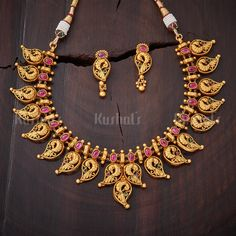 Traditionally crafted #antique #necklace studded with #ruby stones and plated with #gold polish #kushalsfashionjewellery