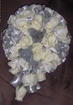 white and silver bouquet - mix in some blue or have blue and white for the bridesmaids