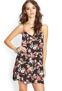 Style Deals - This soft chiffon cami dress features an allover floral print and tiered hem. Compl...