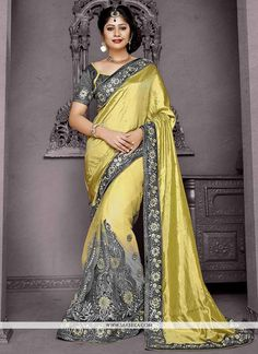 This grey and yellow net and silk trendy saree is accenting the charming feeling. The embroidered and patch border work appears to be chic and fantastic for any function. Comes with matching blouse. (...