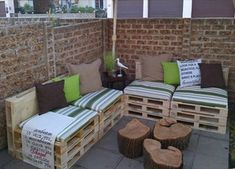 Furniture, Charming Tree Trunk Coffee Table With Wooden Pallet Couch Also Green Striped Pads And Colorful Cushions In Traditional Patio Design With Bricks Wall: Cool DIY Wooden Pallet Couch Designs