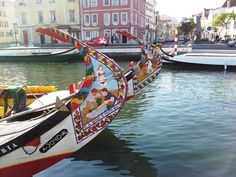 Painted #moliceiros (small boats) in the canals of #Aveiro #Portugal