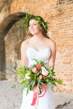 Styled shoot bouquet with Lacher's Lens Photography featuring funky boho beach flowers including white, peach, and burgundy blooms of protea, garden roses, scabiosa, brunia, hypericum, and assorted greens. #bridalbouquet #beachbride #beachwedding #beachflowers #tropicalflowers