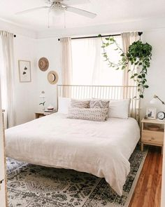 Linen Venice Set Master bedroom with white iron bedframe, neutral bedding and filled with plants. Display hats on the wall as decor. Home Design, Interior Design, Design Ideas, Design Inspiration, Travel Inspiration, Linen Duvet, Cozy Bedroom, Simple Bedroom Decor, Bedroom Romantic