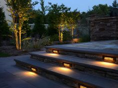 Well-lit steps make the space functional for nighttime get togeters.