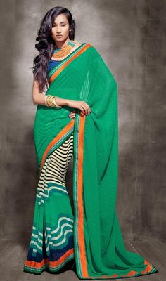 Black, cream and green embroidered georgette sari is a tri color casual sari which is beautified with wavy printed lines and silk thread embroidered lace which gives you an alluring look. Sari comes with contrast blue raw silk stitched blouse as shown in the picture. #PrintedDesignCasualSaree
