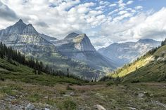 """ Catching a View from the Going-to-the-Sun Road - Glacier NP "". When I arrived, the air was thick with smoke from the fires in and near the park as well as smoke being blown in from Washington, Oregon and Idaho fires. Luckily it was raining in Washington and Oregon, and the next day we woke to the natural beauty of the area. Going-to-the-Sun Road was completed in 1932 and bisects the park, passing over the Continental Divide. The park is split into West Glacier and East Glacier with..."